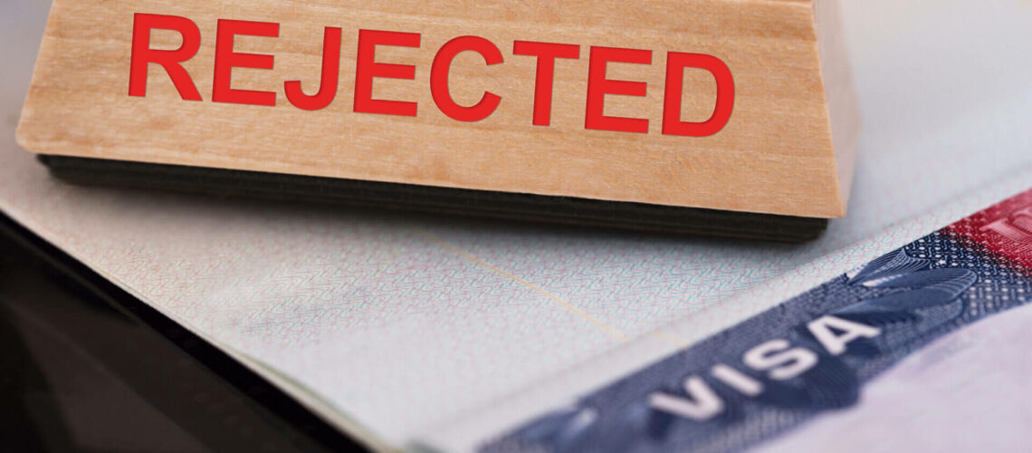Close-up Photo Of Rejected Stamp On Visa